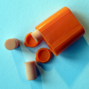 Simple roll-up foam ear plugs that can be used at concerts or racing events.